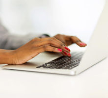 Photo: Hands at a laptop keyboard
