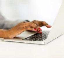 Photo: Hands at a laptop keyboard